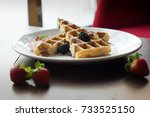 fresh waffles with strawberries ... | Shutterstock . vector #733525150