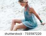 young woman on the beach with... | Shutterstock . vector #733587220