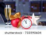 Small photo of Glass of champagne and alarm clock within an inch of new 2018 year and christmas eve in festive decor office closeup. New happy life and business success expectations on the threshold of holy feast