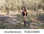 girl walking in the forest with ... | Shutterstock . vector #733610080