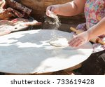 Woman Rolling Dough With...