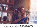 beautiful young woman sitting...   Shutterstock . vector #733624474