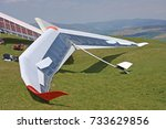 Hang Gliders Prepared To Fly