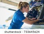 female aero engineer working on ... | Shutterstock . vector #733645624
