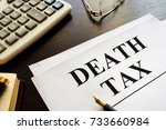 Small photo of Death tax documents and pen on a table.