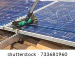 cleaning solar panels on house... | Shutterstock . vector #733681960