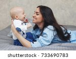 happy young mother with the... | Shutterstock . vector #733690783