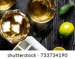 Glass Of Scotch On Dark Wooden...