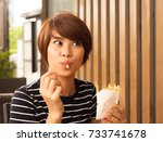 women enjoy eating with her... | Shutterstock . vector #733741678