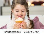 cute girl eating muffin | Shutterstock . vector #733752754