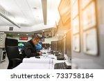 control room operator checking... | Shutterstock . vector #733758184