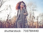 outdoor fashion photo of young... | Shutterstock . vector #733784440