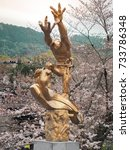 Small photo of Keage Incline, Kyoto, Japan - April 5, 2017 : Gold figure sculpture installed in front of keage incline railway station. Landmark for spring scenery of amazing cherry blossoms in Kyoto