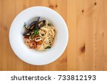 seafood pasta in white plate.... | Shutterstock . vector #733812193