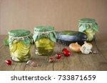 pickled zucchini in glass jar...   Shutterstock . vector #733871659
