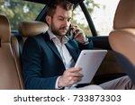 handsome businessman using... | Shutterstock . vector #733873303