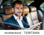 handsome business man in car.... | Shutterstock . vector #733873606