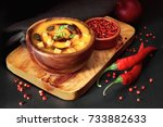 spicy pumpkin soup in wooden... | Shutterstock . vector #733882633