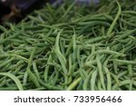 green beans at a farmers market | Shutterstock . vector #733956466