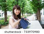 Woman Looking At A Bag