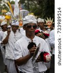 Small photo of Seseh Village, Bali, Indonesia - March 26 2017 - Hindu villagers in ceremonial dress take part in a Melasti pilgrimage - a traditional parade occurring in days before Nyepi Day (Day of Silence)