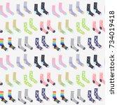 funny cute socks seamless...   Shutterstock .eps vector #734019418