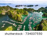 floating fishing village and... | Shutterstock . vector #734037550