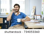 young man sitting at desk at... | Shutterstock . vector #734053360