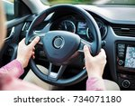 man presses the buttons on the... | Shutterstock . vector #734071180