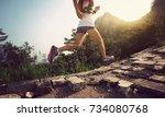 fitness woman trail runner... | Shutterstock . vector #734080768