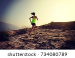 fitness woman trail runner... | Shutterstock . vector #734080789
