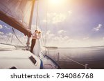 white yacht with sail set goes... | Shutterstock . vector #734086768