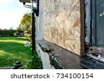boarded up cottage window  seen ... | Shutterstock . vector #734100154