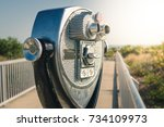 coin operated binoculars on a... | Shutterstock . vector #734109973