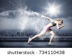 sporty woman running on a white ... | Shutterstock . vector #734110438