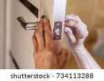 man repairing the doorknob....   Shutterstock . vector #734113288