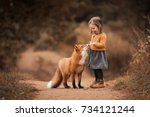a little girl with a fox in...   Shutterstock . vector #734121244