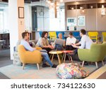 group of a young business... | Shutterstock . vector #734122630
