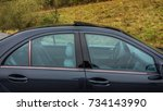 Small photo of Cluj-Napoca, Romania - Octomber 10, 2017: Isolated blue tinted windows, Mercedes-Benz C class - alias W203, black metallic colour, chrome ornaments, year 2005,open sun roof, right side, closed windows