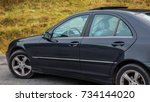 Small photo of Cluj-Napoca, Romania - Octomber 10, 2017: Isolated blue tinted windows, Mercedes-Benz C class - alias W203, black metallic colour, chrome ornaments, year 2005,open sun roof, left side, closed windows
