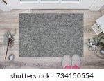 blank grey doormat before the... | Shutterstock . vector #734150554