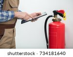 close up of technician using... | Shutterstock . vector #734181640