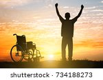 Small photo of Silhouette Of Miracle Handicapped Man Walking Again At Sunset