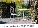 white forged furniture in the... | Shutterstock . vector #734189980
