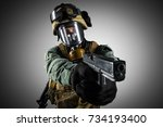 soldier holding assault rifle.... | Shutterstock . vector #734193400