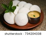 Small photo of Many Idli with coconut chutney, popular South Indian breakfast dish made with lentil, rice. prepared by steaming fermented batter. Healthy and oil free traditional breakfast Kerala, India.