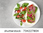 plate with delicious sausage... | Shutterstock . vector #734227804