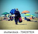 Small photo of African towel and shorts seller in the resort beach with vintage effect