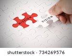 hand holding piece of jigsaw... | Shutterstock . vector #734269576