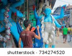 Small photo of KUMARTULI, KOLKATA, INDIA - OCTOBER 10, 2014 - Artist preparing clay idol to be worshipped as Goddess Kali, during Kali Puja, Hindu festival of Deepavali or Diwali. Celebtated all over India.